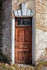Old brown painted door.