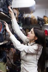 woman chooses bag at shop