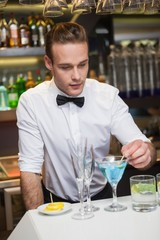 Bartender preparing a drink at bar counter