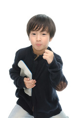 Little asian boy holding tablet and showing success sign