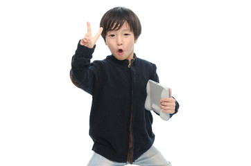 Little asian boy holding tablet and showing victory sign