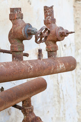 corroded water pipe with broken faucets