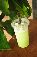 smoothies milk green tea with a straw