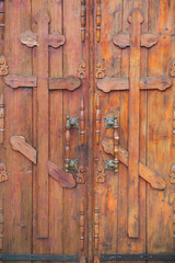 Closeup of old wooden doors with orthodox crosses