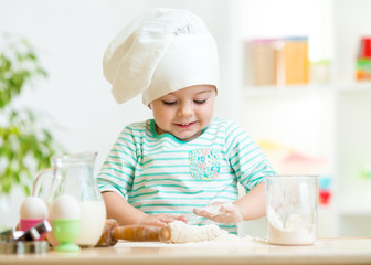 smiling baker kid girl in chef hat