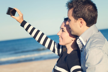 Young couple taking selfie with retro filter effect