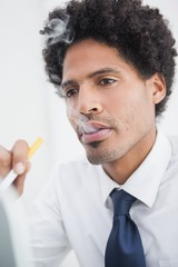 Portrait of a businessman smoking