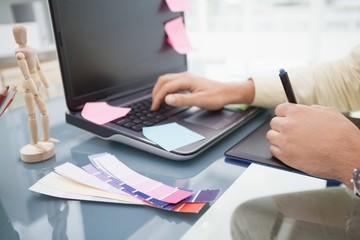 Designer using laptop and digitizer