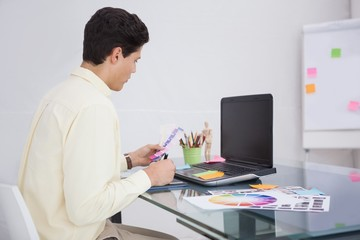 Designer using digitizer and colour sample