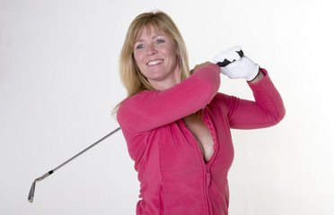 Attractive mid age female golfer