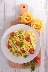 tagliatelle cooked with courgette and tomato