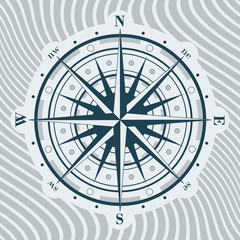 Compass rose over background with waves