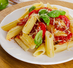 Penne pasta with  a  bolognese  sauce on   plate