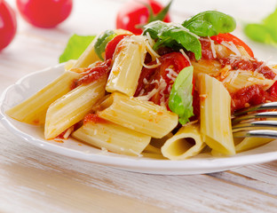 Penne pasta with  a  bolognese  sauce on  white plate