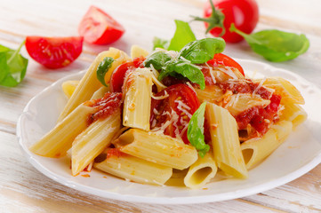 Penne pasta with a  bolognese  sauce on the white wooden  table