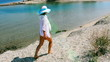 Woman walking the sunny coastline