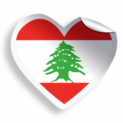 Heart sticker with flag of Lebanon isolated on white