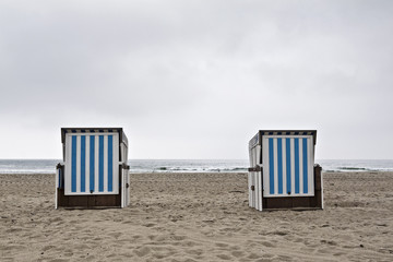 Two beach chairs on a cloudy day
