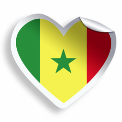 Heart sticker with flag of Senegal isolated on white