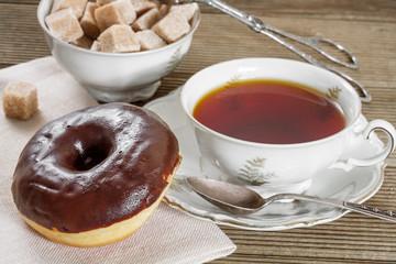 Chocolate donut with hot tea