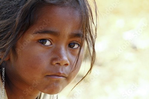 Poverty, portrait of a poor little African girl lost in deep tho - 73410616