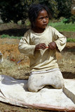 Poverty, portrait of a poor little African girl lost in deep tho poster
