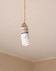 Electrical Energy saving light bulb in white chuck hanging