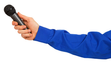 Man's hand in a blue shirt holding a microphone