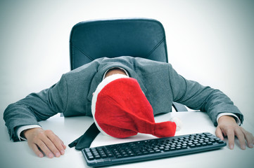 man sleeping in the office after a christmas party