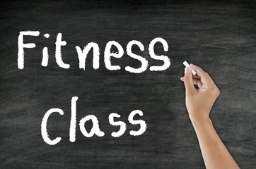 "handwriting ""Fitness class"" on blackboard"