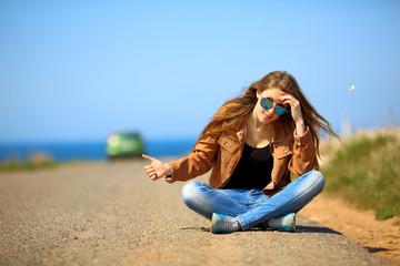 beautiful girl posing on the road