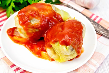 Cabbage stuffed with sauce in plate on board