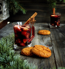 cups of hot Christmas mulled wine with cake