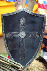 Knight's metal shield with christian cross