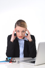 young woman working in stress at office computer frustrated