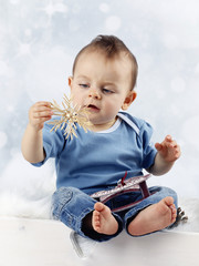 Little child with straw christmas decoration