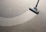 Vacuum cleaner on a carpet with an extra clean strip poster