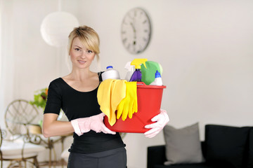 Woman with detergent for wash house