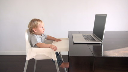 blonde baby watching pc