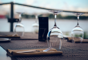 Empty glasses on a table in a restaurant