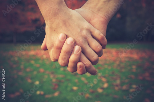 canvas print picture Couple holding hands in park
