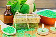 Soap homemade and salt with nettles in mortar on board