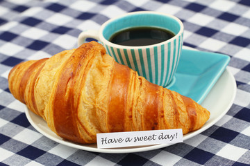 Have a sweet day with croissant and coffee