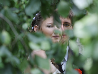 Portrait of bride and groom in summer park