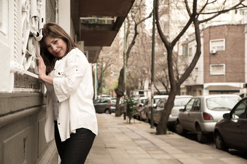 Beautiful mature woman cheerful on streets of Buenos Aires