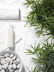 Bamboo leaves and a white towel for a massage background