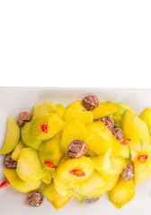 pickled young mango with dried tamarind and chili slices