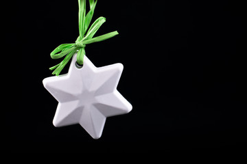 Christmas tree decoration. Star. On black.