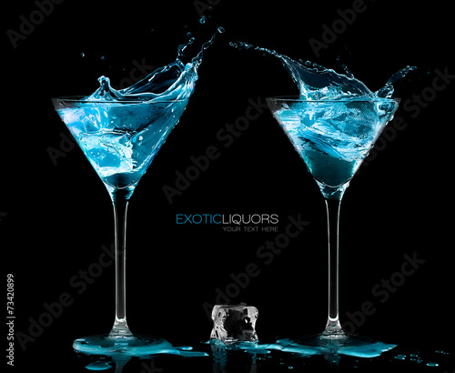 Cocktail Glasses with Blue Vodka. Style and Celebration Concept - 73420899