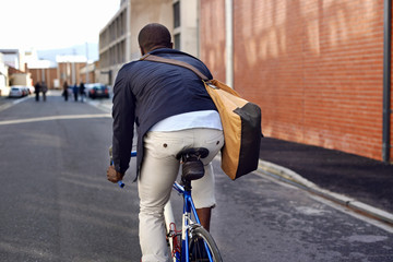 riding bike black man
